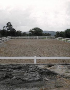 narrow side of horse arena fence