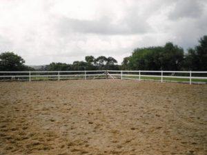 inside shot horse arena fence